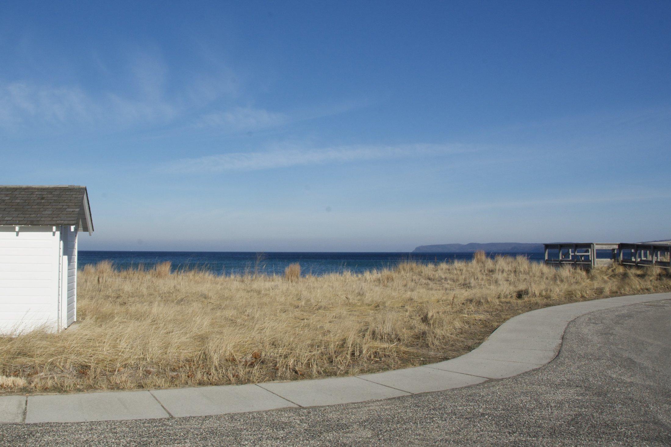 Sweeping curve of sidewalk with Sleeping Bear Bay beyond