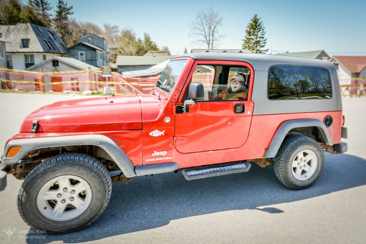Keith in the Red Jeep